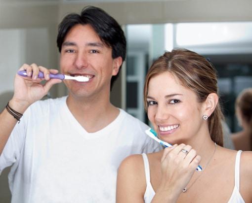 Gum Disease - Couple Brushing